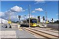 SJ7796 : Metrolink Tram at Barton Dock Road by David Dixon