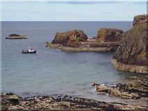 NT6779 : A small boat enters Dunbar Harbour by Jennifer Petrie