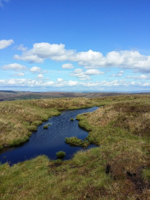 Pond on the moors close to Whins Brow trig pillar