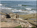NZ3376 : Worked Stone, Rocky Island, Seaton Sluice by Geoff Holland
