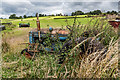 SK0346 : Old Overgrown Tractor by Brian Deegan