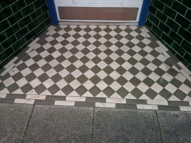 A tiled shop doorway on Vaughan Street, Llandudno by Meirion