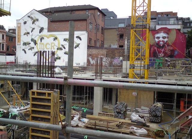 Murals behind the building work