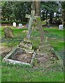 TF3947 : Two graves bonding in Leverton churchyard by Neil Theasby