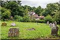 SO5874 : Graveyard, Church of St John the Baptist by Ian Capper