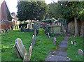 SO8932 : Graveyard behind the Old Baptist chapel, Tewkesbury by Chris Allen