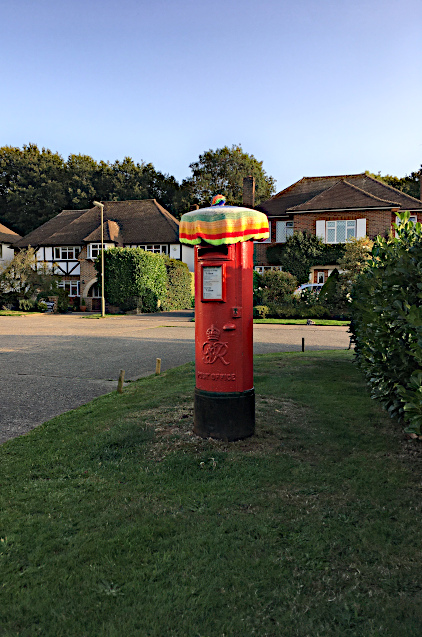 Post box with sun hat on Oak Hill