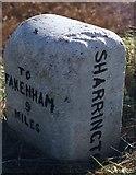 TG0337 : Old Milestone (east face) on the A148, near Sharrington by CW Haines