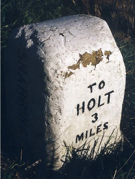 Old Milestone (west face) on the A148, near Sharrington