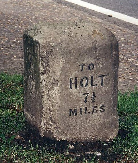 Old Milestone (west face) by the A148, Holt Road, by Kettlestone Belts