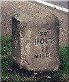 TF9732 : Old Milestone (west face) by the A148, Holt Road, by Kettlestone Belts by CW Haines