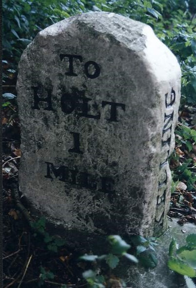 Old Milestone ( east face) by the A148, Cromer Road, High Kelling