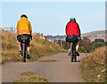 NU0150 : Cyclists on the Northumberland Coast Path by Walter Baxter