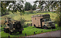 NZ0948 : Military-style vehicles beside farm road by Trevor Littlewood