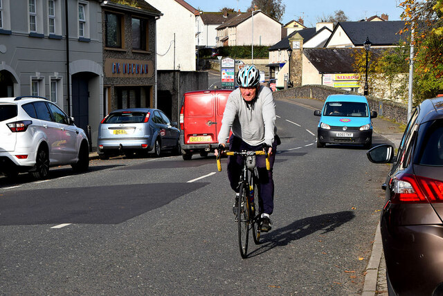 A cyclist passes by, Drumquin
