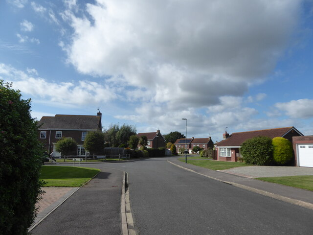 Approaching the junction of Grange Field Way and Larchfield Close