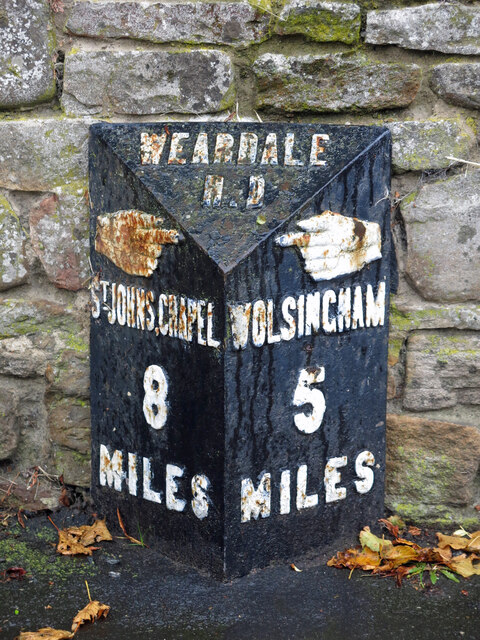 Milestone, East End (A689) / Bondisle Way