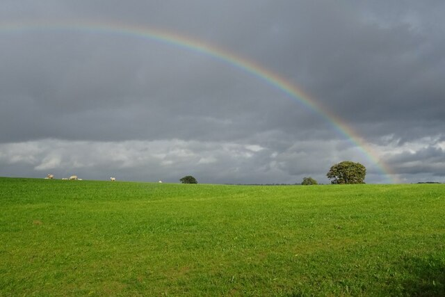 Rainbow over farmland