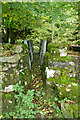 SD9796 : Footbridge above the falls in Haverdale Beck by Andy Waddington