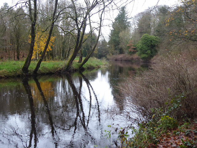Tranquil reflections along the Camowen River