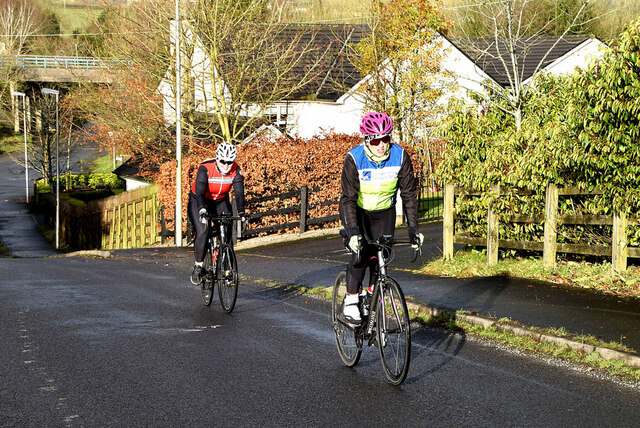 Cyclists powering up a steep hill