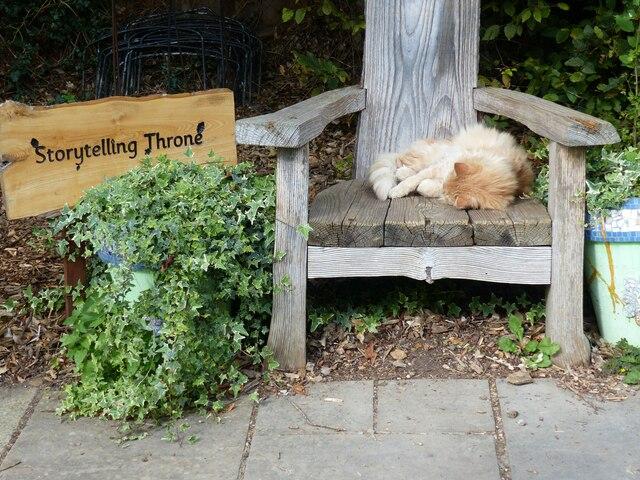 """Storytelling Throne"" with occupant, Cambridge University Botanical Garden"
