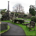 SS9379 : Pathside bench in the village churchyard, Coychurch by Jaggery