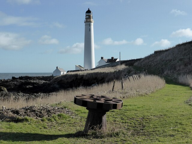 Capstan and lighthouse at Scurdie Ness