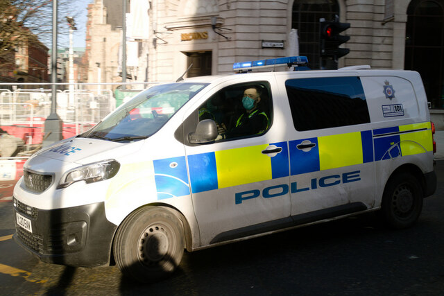 Police van turning in to Park Row from The Headrow