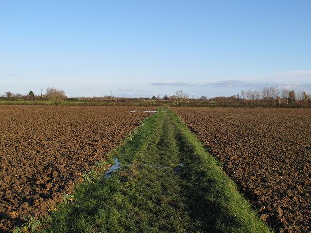 Footpath to Joyce's Farm through tilled arable land