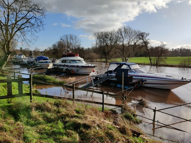 Moored boats along a flooded River Severn
