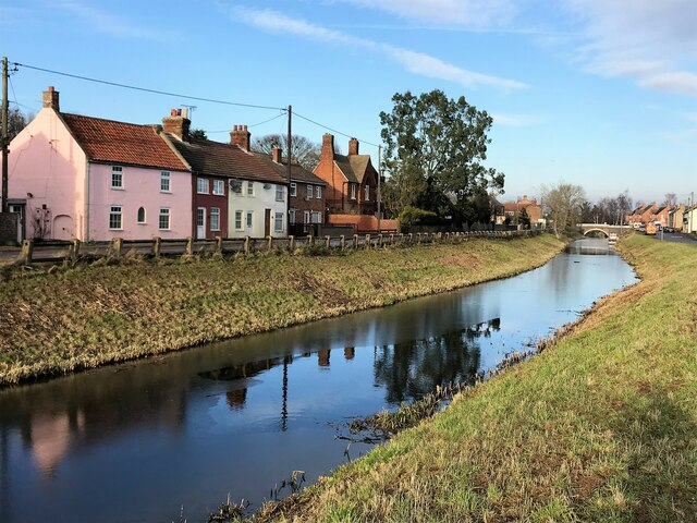 Colourful houses overlooking the Well Creek in Outwell, Norfolk