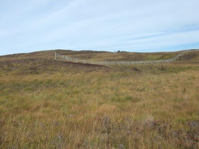Fence end, Loch Monaghan by Richard Webb