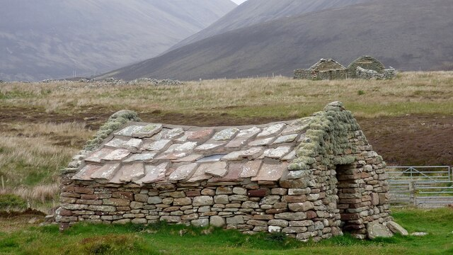 Restored vernacular barn with slab roof by Sandy Gerrard