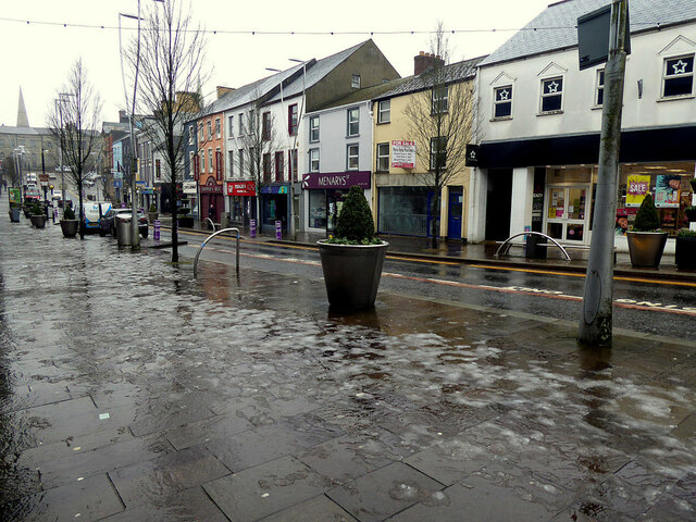 Thawing ice on the footpath, High Street, Omagh