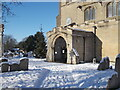 TF1505 : Porch of St. Benedict's Church, Glinton, in the snow by Paul Bryan