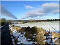 NZ1152 : Snowy field beside Elm Park Road by Robert Graham