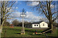 TM0667 : Cotton village sign and village hall by Adrian S Pye