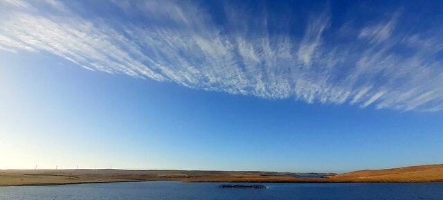 Blue skies over Loch of Snarravoe