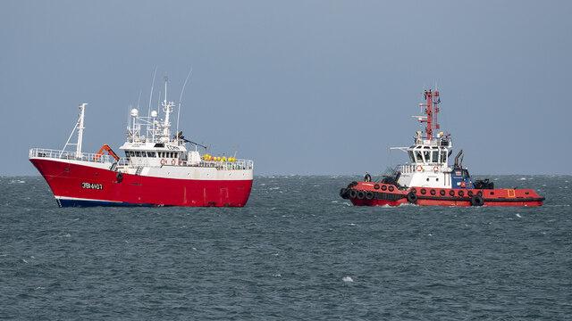 Fishing boat and tug off Bangor