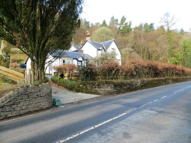 Roadside house at the edge of Mambeg Wood
