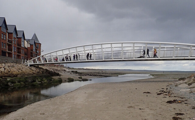 Pedestrians crossing the Promenade Footbridge over the Shimna Estuary