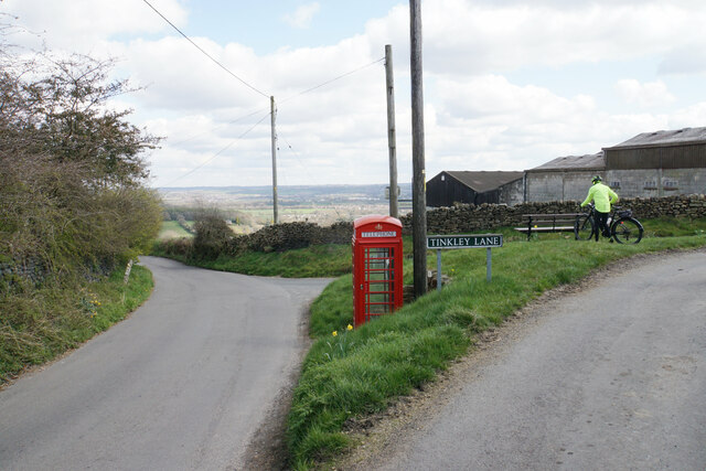 Telephone box and bench at the end of Tinkley Lane