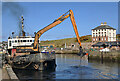 NT9464 : A dredger working at Eyemouth Harbour by Walter Baxter