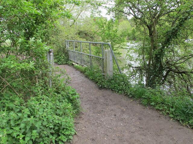 Footbridge with benchmark, on Thames walk