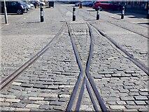 NT2676 : Rails of West Old Dock by Richard Webb