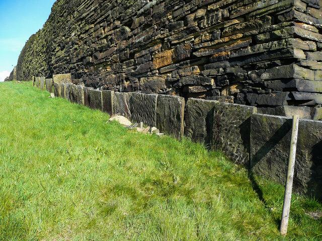 Slab wall enclosing a footpath alongside a judd wall, Northowram