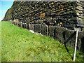 SE1027 : Slab wall enclosing a footpath alongside a judd wall, Northowram by Humphrey Bolton
