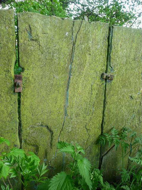 Close view of stone slab wall showing iron fixings, Northowram