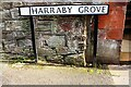 NY4154 : Benchmark on the Harraby Grove face of the Harraby Pub by Roger Templeman